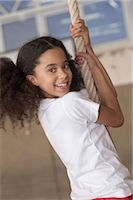 preteen touch - Girl Climbing a Rope at School Stock Photo - Premium Royalty-Freenull, Code: 6106-07005949