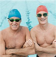seniors and swim cap - Portrait of Two Senior Men in Swimming Caps and Goggles Standing Side by Side in a Pool Stock Photo - Premium Royalty-Freenull, Code: 6106-07006108