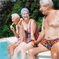 seniors and swim cap - Three Seniors Dipping Their Legs into a Swimming Pool and Eating Ice Creams Stock Photo - Premium Royalty-Freenull, Code: 6106-07006202