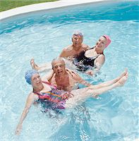 Four Senior People in a Swimming Pool Stock Photo - Premium Royalty-Freenull, Code: 6106-07006205