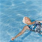 Senior Woman Swimming on Her back in Swimming Pool Stock Photo - Premium Royalty-Free, Artist: Ikon Images, Code: 6106-07006209
