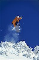 sports and snowboarding - Young Woman Freestyle Snowboarding, Mid Air Shot Stock Photo - Premium Royalty-Freenull, Code: 6106-07006237