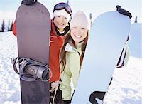 sports and snowboarding - Portrait of Two Young Women Holding Snowboards Stock Photo - Premium Royalty-Freenull, Code: 6106-07006666
