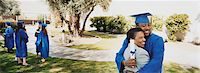 Mother and Son Hugging on Campus at His Graduation Stock Photo - Premium Royalty-Freenull, Code: 6106-07006727
