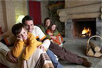 sweater and fireplace - Family in a Holiday Home on a Winter Vacation Stock Photo - Premium Royalty-Freenull, Code: 6106-07007059