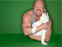 Studio Portrait of a Muscular Man Being Licked by a Bulldog Stock Photo - Premium Royalty-Freenull, Code: 6106-07007375