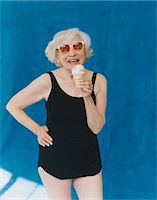Portrait of a Senior Adult Holding an Ice Cream With Her Hand on Her Hip Stock Photo - Premium Royalty-Freenull, Code: 6106-07007421