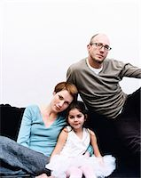 Portrait of a Couple With Their Young Daughter Stock Photo - Premium Royalty-Freenull, Code: 6106-07009179