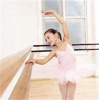 pantyhose kid - Young Girl in a Tutu Practises Ballet in a Studio Stock Photo - Premium Royalty-Freenull, Code: 6106-07009528