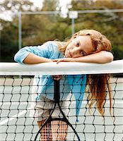 preteen touch - Portrait of a Young Girl Leaning on a Net in a Tennis Court Stock Photo - Premium Royalty-Freenull, Code: 6106-07009682