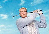 swing (sports) - Portrait of a Golfer Swinging a Golf Club Stock Photo - Premium Royalty-Freenull, Code: 6106-07009775