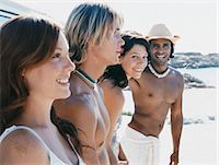Four people in Summer Outfits Standing Outdoors Stock Photo - Premium Royalty-Freenull, Code: 6106-07009913