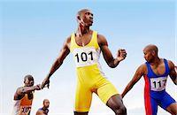 sprint - Relay Runners Passing Batons to Team Mates Stock Photo - Premium Royalty-Freenull, Code: 6106-07010230