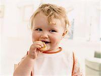 Young Child Eating Stock Photo - Premium Royalty-Freenull, Code: 6106-07010644
