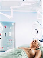 Woman Lying in an Operation Room With Dotted Lines Marked on Her Breasts Stock Photo - Premium Royalty-Freenull, Code: 6106-07010767