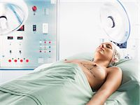 Woman Lying in an Operation Room With Dotted Lines Marked on Her Breasts Stock Photo - Premium Royalty-Freenull, Code: 6106-07010768