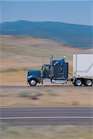 side view tractor trailer truck - Cab of truck with passing scenery Stock Photo - Premium Royalt