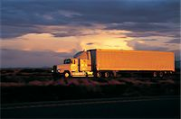 side view tractor trailer truck - Reflection of sunset off truck Stock Photo - Premium Royalty-Freenull, Code: 6106-07011028