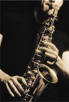 Saxophone being played Stock Photo - Premium Royalty-Freenull, Code: 6106-07011201