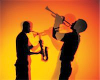 Silhouette of men playing trumpet & saxophone Stock Photo - Premium Royalty-Freenull, Code: 6106-07011204