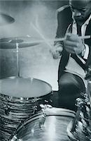 Drummer playing on drum set Stock Photo - Premium Royalty-Freenull, Code: 6106-07011240