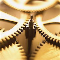Close up of interlocking Cogs in a Clockwork Mechanism Stock Photo - Premium Royalty-Freenull, Code: 6106-07013206