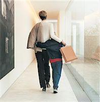 Businesswoman walking with son Stock Photo - Premium Royalty-Freenull, Code: 6106-07013264