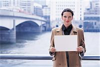 person holding sign - Woman holding a blank piece of paper Stock Photo - Premium Royalty-Freenull, Code: 6106-07013939