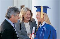 Girl in Graduation Cap and Gown with Parents Stock Photo - Premium Royalty-Freenull, Code: 6106-07014992