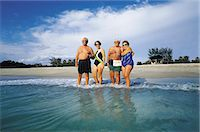 seniors woman in swimsuit - Two Couples on the Beach Stock Photo - Premium Royalty-Freenull, Code: 6106-07015310
