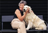 Portrait of a Woman With Her Dog Stock Photo - Premium Royalty-Freenull, Code: 6106-07015378
