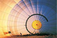 Man Working on a Hot Air Balloon Stock Photo - Premium Royalty-Freenull, Code: 6106-07016710