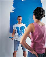 Couple Painting Wall, Man Covered In Paint Stock Photo - Premium Royalty-Freenull, Code: 6106-07017036