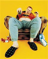 fat man full body - Portrait of a Couch Potato Stock Photo - Premium Royalty-Freenull, Code: 6106-07018235
