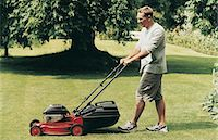 Man Mowing His Lawn During Summer Stock Photo - Premium Royalty-Freenull, Code: 6106-07018308