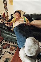 fat man full body - Fat Man on a Sofa Watching TV Stock Photo - Premium Royalty-Freenull, Code: 6106-07018459