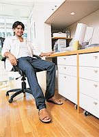Portrait of a Businessman Sitting in a Home Office Stock Photo - Premium Royalty-Freenull, Code: 6106-07018752