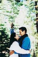 Man and a Woman About to Kiss Under the Mistletoe Stock Photo - Premium Royalty-Freenull, Code: 6106-07020295