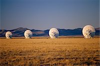 radio telescope - Arrays/satellite dishes scattered in field Stock Photo - Premium Royalty-Freenull, Code: 6106-07020899