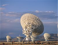 radio telescope - Array/satellite dishes in various positions Stock Photo - Premium Royalty-Freenull, Code: 6106-07020914