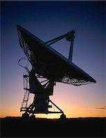 radio telescope - Array/satellite dish silhouetted by sunset Stock Photo - Premium Royalty-Freenull, Code: 6106-07020916