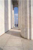Columns at Lincoln Memorial with Washington Monument in distance Stock Photo - Premium Royalty-Freenull, Code: 6106-07020992