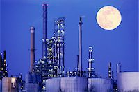 refinery - Chemical manufacturing plant with full moon Stock Photo - Premium Royalty-Freenull, Code: 6106-07021237