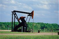 refinery - Pump jack at oil well Stock Photo - Premium Royalty-Freenull, Code: 6106-07021300