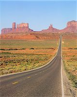 Desert highway with mesas and buttes Stock Photo - Premium Royalty-Freenull, Code: 6106-07021319
