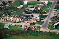 Trailer homes and houses destroyed by tornado Stock Photo - Premium Royalty-Freenull, Code: 6106-07021409