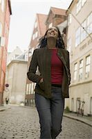 lifestyle portrait of a young adult woman as she goes out sightseeing while on vacation Stock Photo - Premium Royalty-Freenull, Code: 6106-07021576