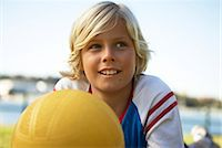 Boy (12-13) with ball outdoors, looking away Stock Photo - Premium Royalty-Freenull, Code: 6106-07022484