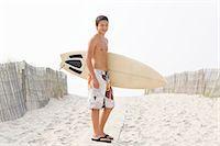 shirtless teen boy - Teenage boy (16-17) standing with surfboard on beach, portrait Stock Photo - Premium Royalty-Freenull, Code: 6106-07022840