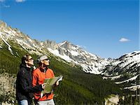 Couple standing on mountain pass looking at map together Stock Photo - Premium Royalty-Freenull, Code: 6106-07023135